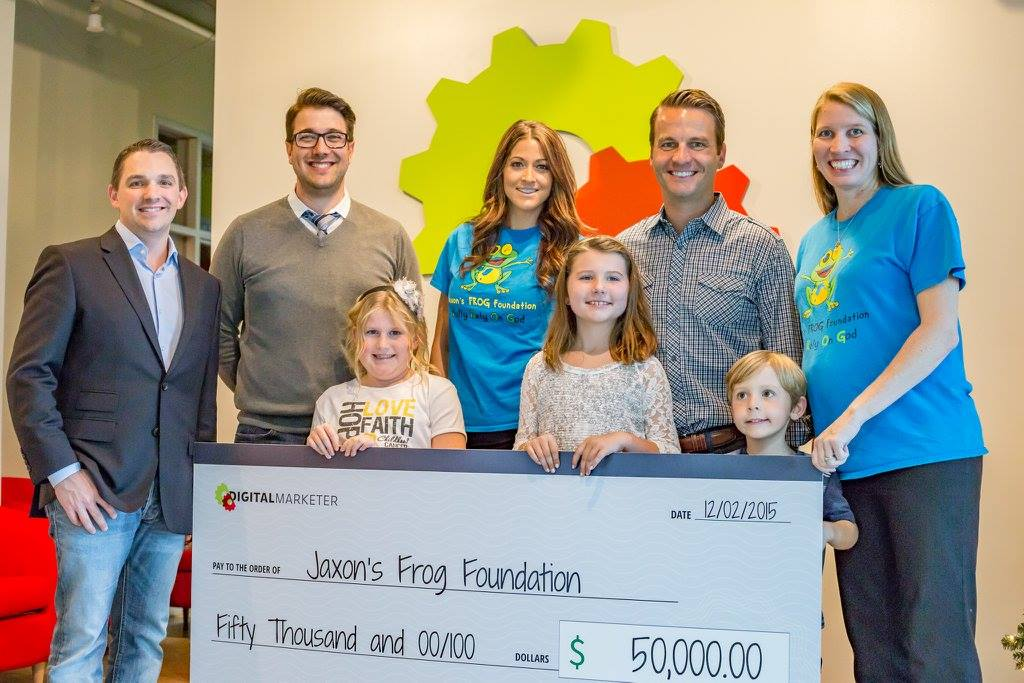 Ryan Deiss and Richard Lindner with team members from Jaxon's FROG Foundation, along with a family helped by this charity