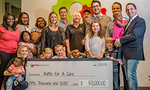 Ryan Deiss and Richard Lindner with team members from Battle for a Cure, as well as several families helped by these charities
