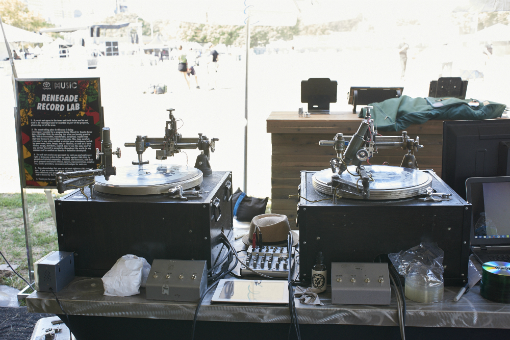 Decades-old machines turn used CDs into playable vinyl at Afropunk