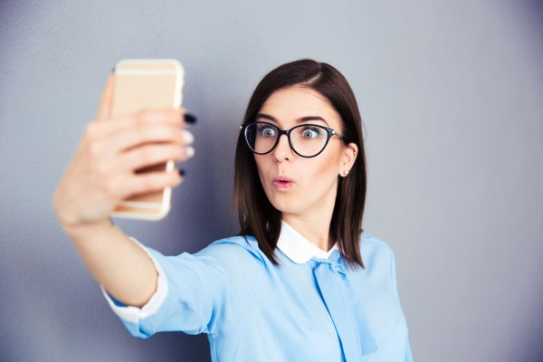 Attractive Woman posting a Selfie