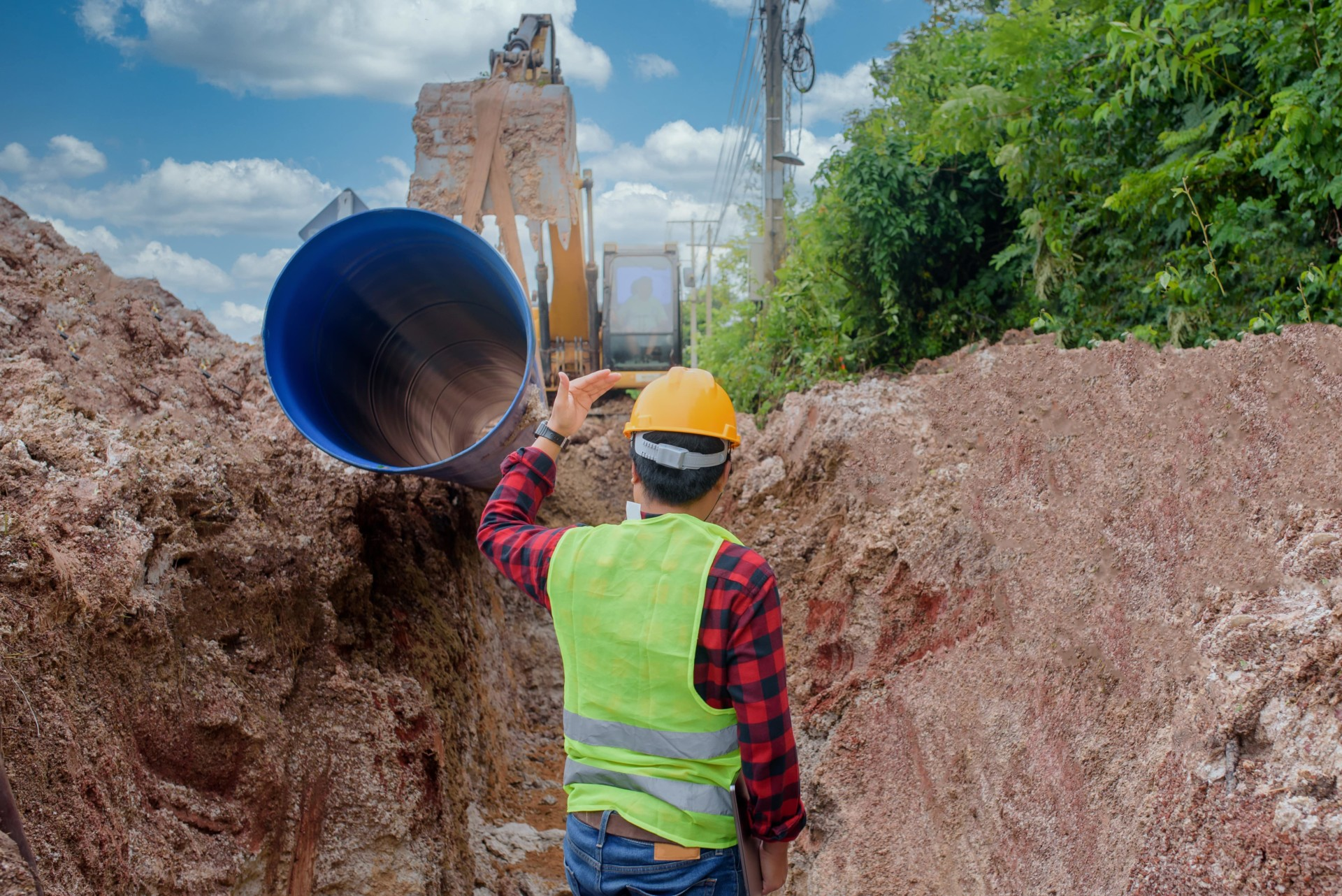 young-asian-engineer-is-inspecting-large-sewer-that-is-buried-underground-construction-site-min
