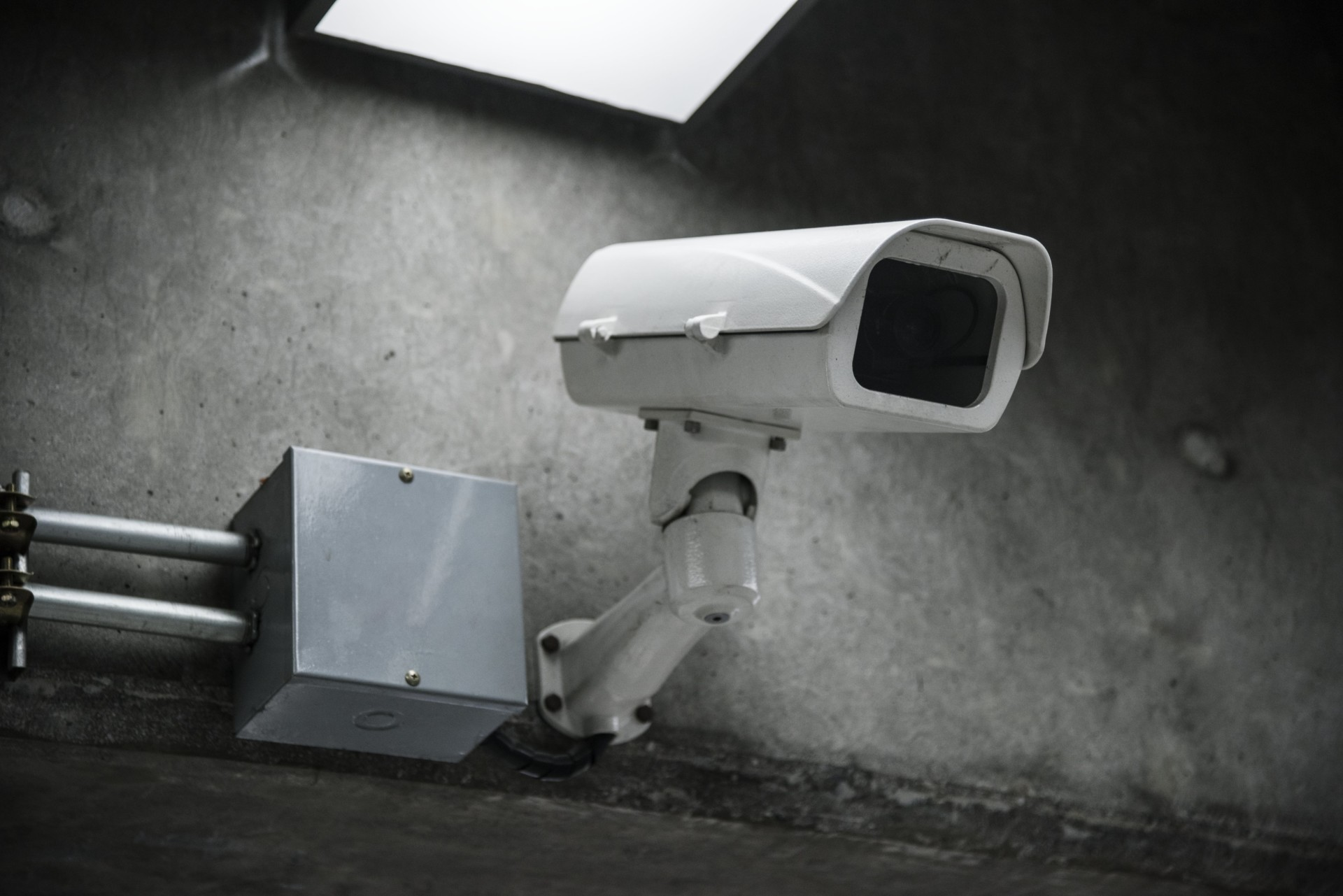 closeup-of-cctv-camera-on-the-wall-min