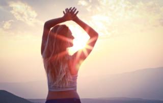 woman on mountain energy healing springtime renewal