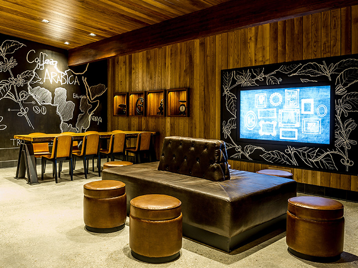 The interior of Starbucks at Disney Springs West Side featuring communal seating and chalkboard design elements