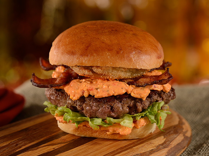 The D Luxe Southern Burger topped with fried green tomatoes, pimento cheese, lettuce and bacon