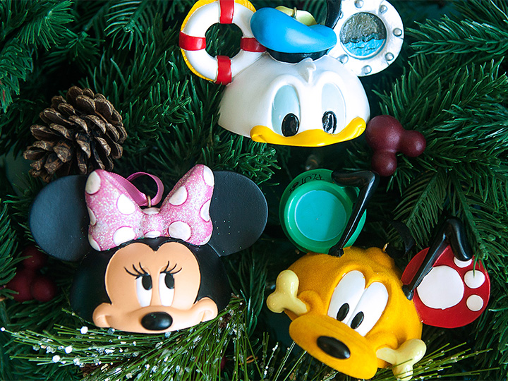 Donald Duck, Pluto and Minnie Mouse Christmas ornaments hang on a tree at the all-new D Living store