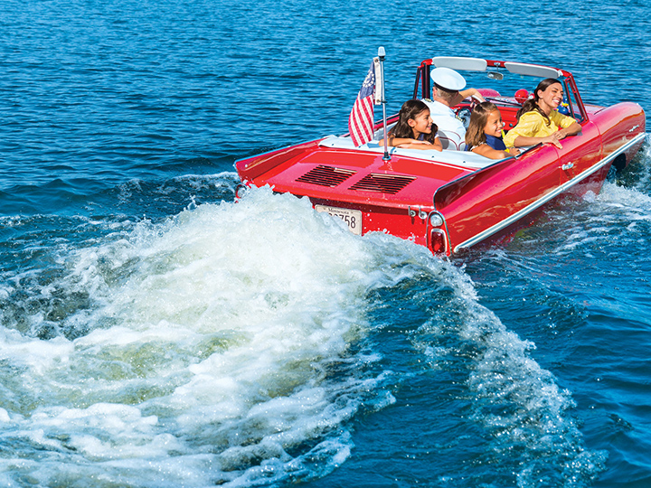 Guests enjoy a ride in an Amphicar