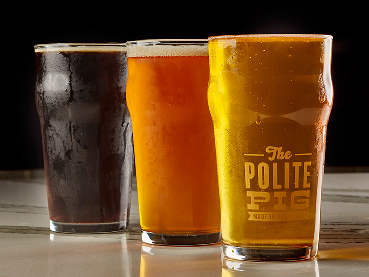 Three glasses of draft beer from The Polite Pig at Disney Springs
