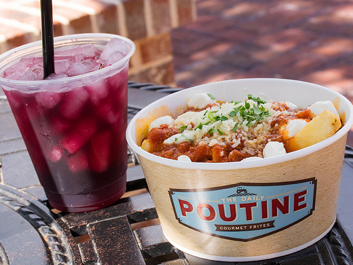 A serving of poutine and a cup of fireball sangria