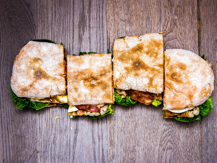 4 sandwich slices with thin bread, bacon, lettuce and other ingredients