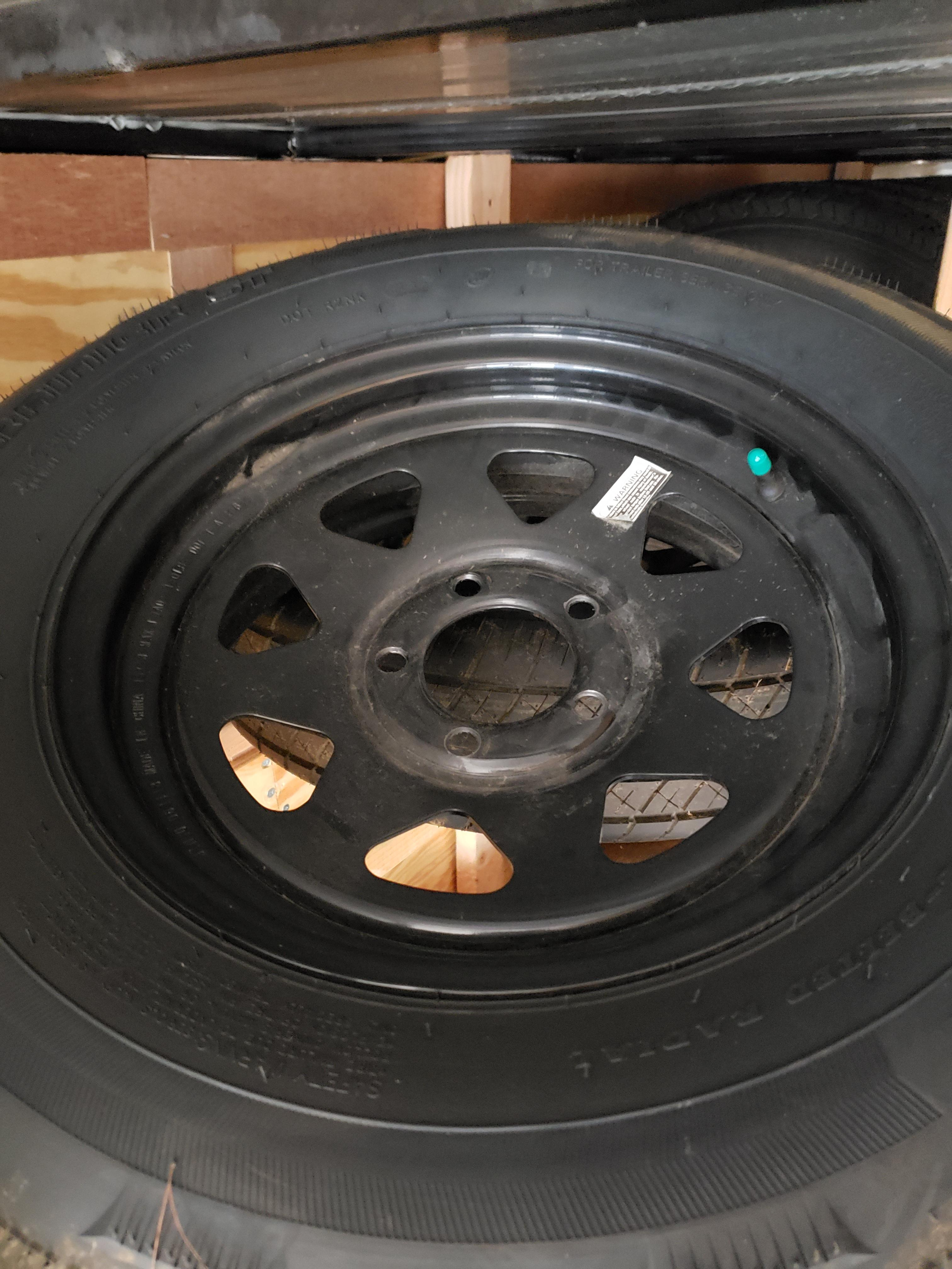 205/75R15 TIRE AND BLACK WHEEL