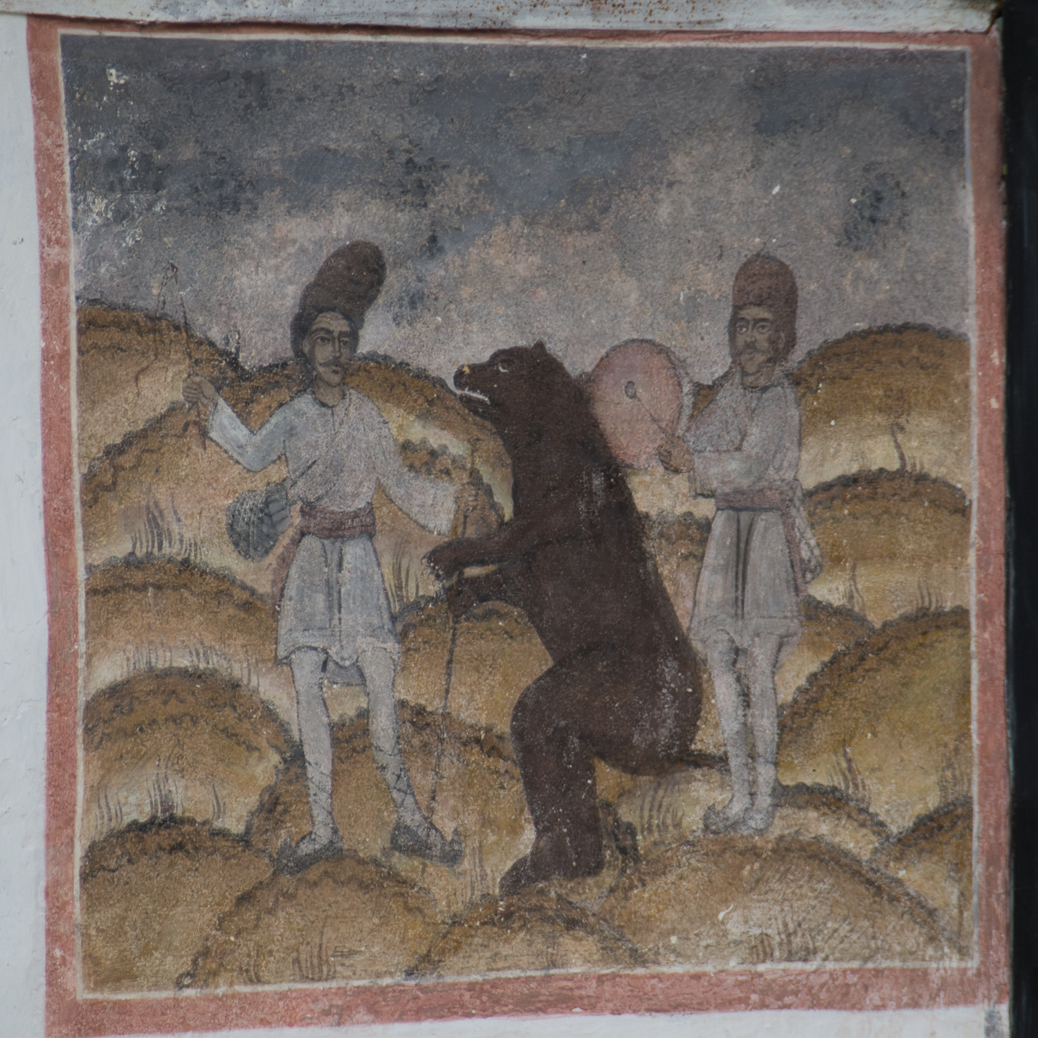 Two men and a bear