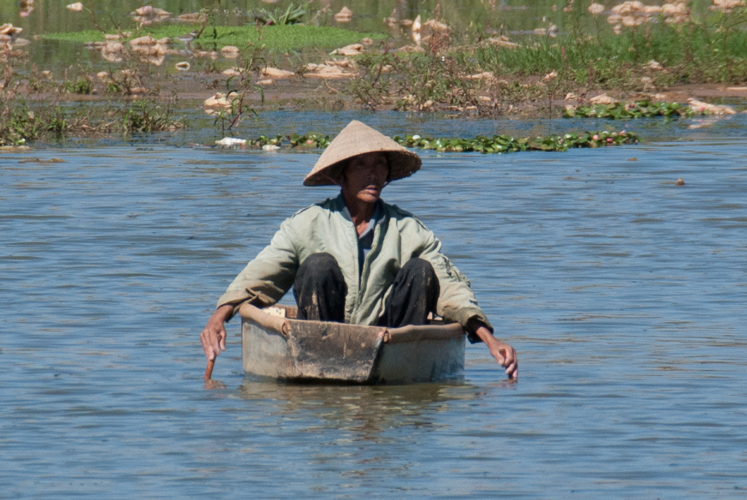 Fisherman wearing Conical Hat