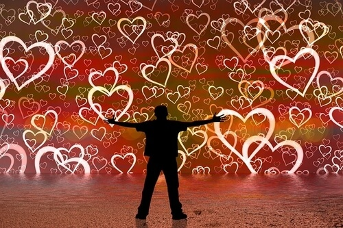 Man in dark outline surrounded by a wall of colorful hearts