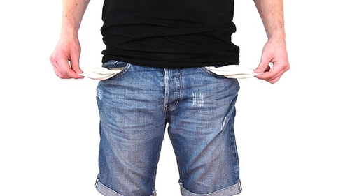 Image of man with empty pockets