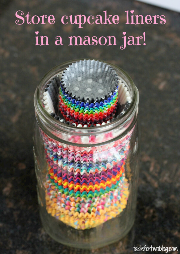 A mason jar can help you easily organize and SEE all the various cupcake liners you've collected over time.