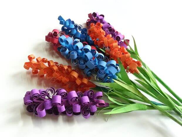 swirly paper flowers blue orange red purple and green
