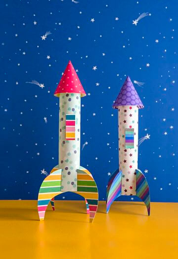bright construction paper rockets against night sky