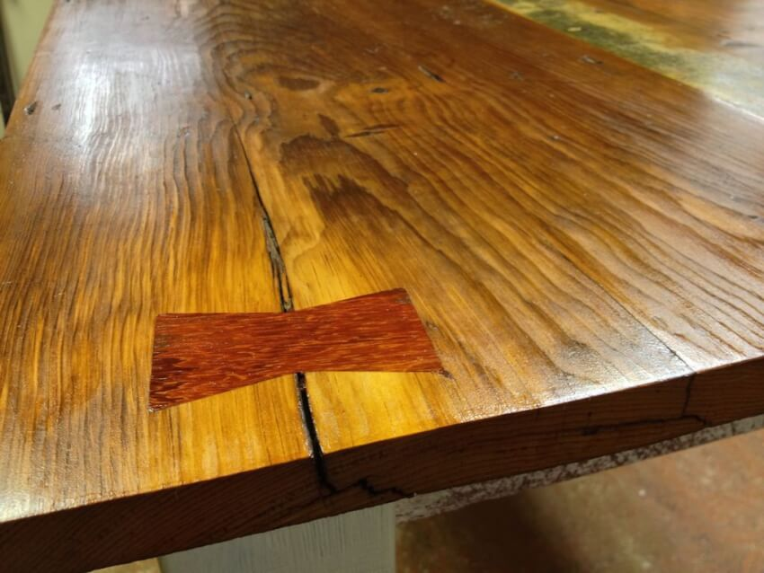 adding an inlay to repair damaged wood in a farmhouse table