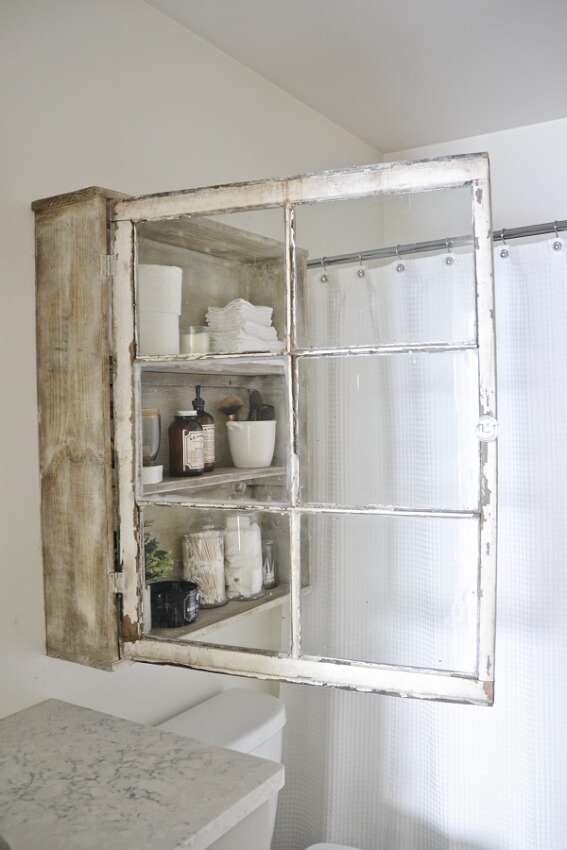 DIY medicine cabinet for bathroom made from a old, rustic window.