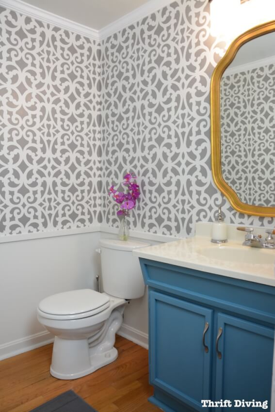 Create an elegant design by stenciling your wall instead of wallpaper.