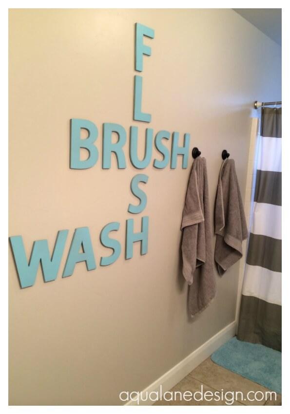 Crossword art in bathroom makes the room creative and fun.