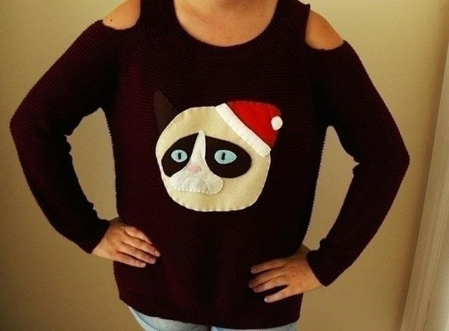This ugly Christmas sweater shows a grumpy cat for those grumpy ugly sweater party goers.