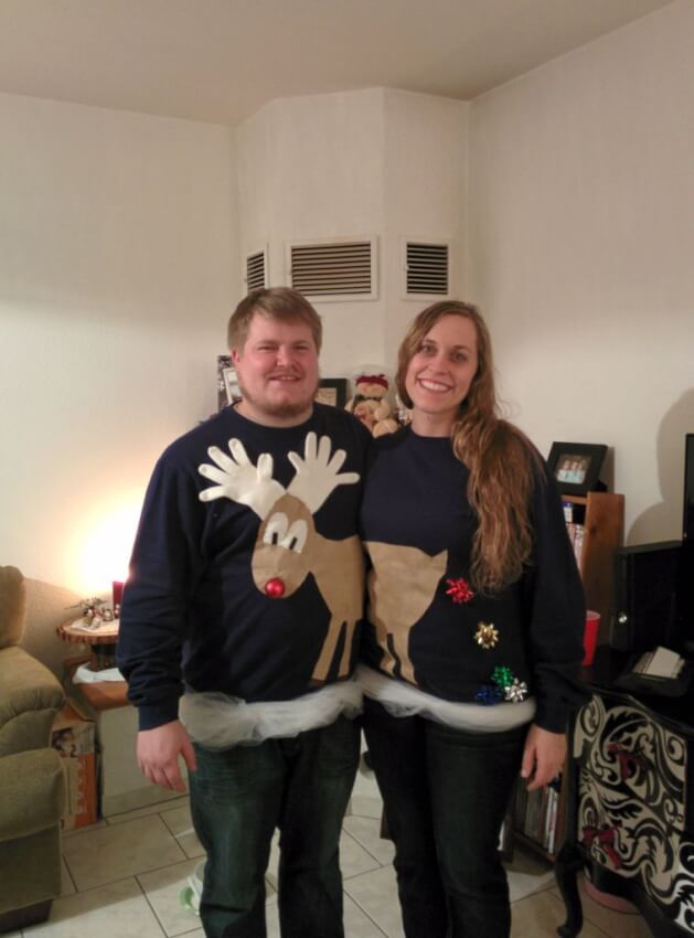A couple making two halves on ugly holiday sweaters come together as one.