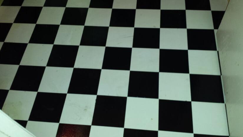 original flooring before stripping for brown paper bag floor