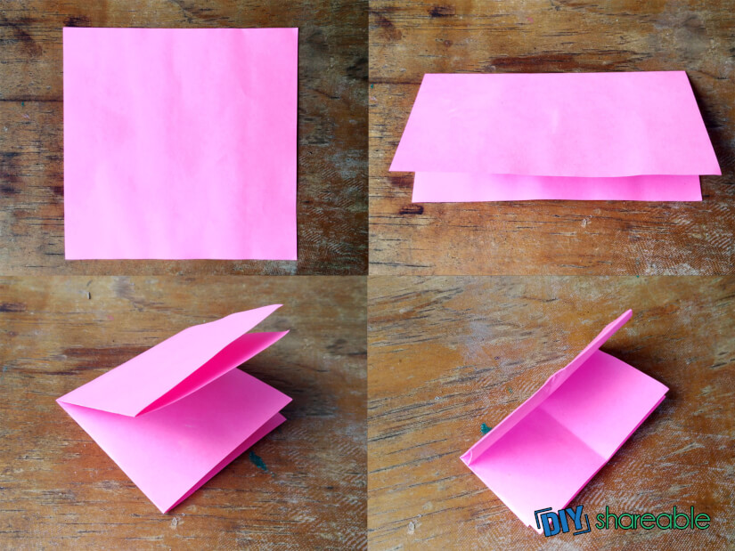 Fold paper in quarters to create an origami fish