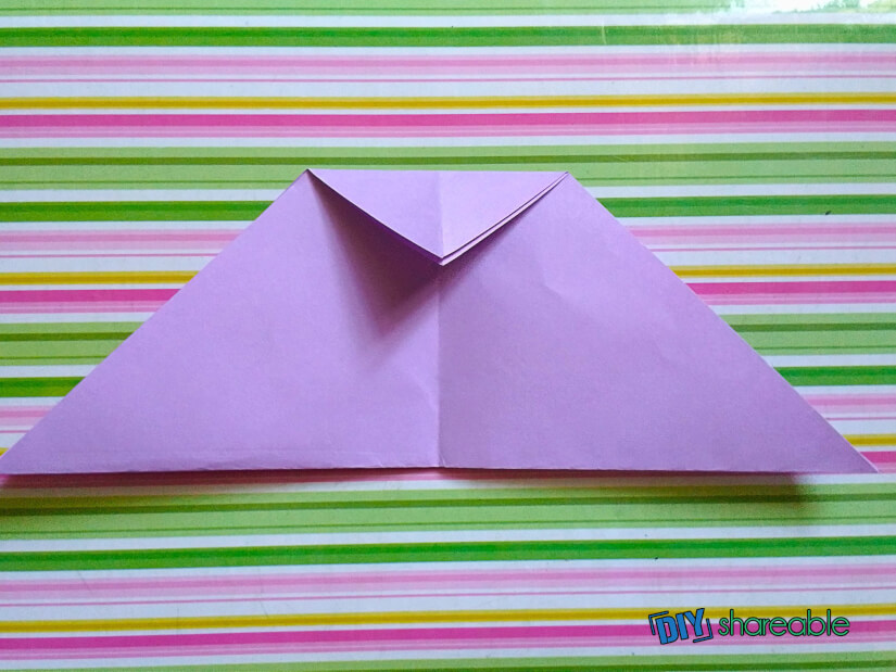 fold triangle down to create the cat