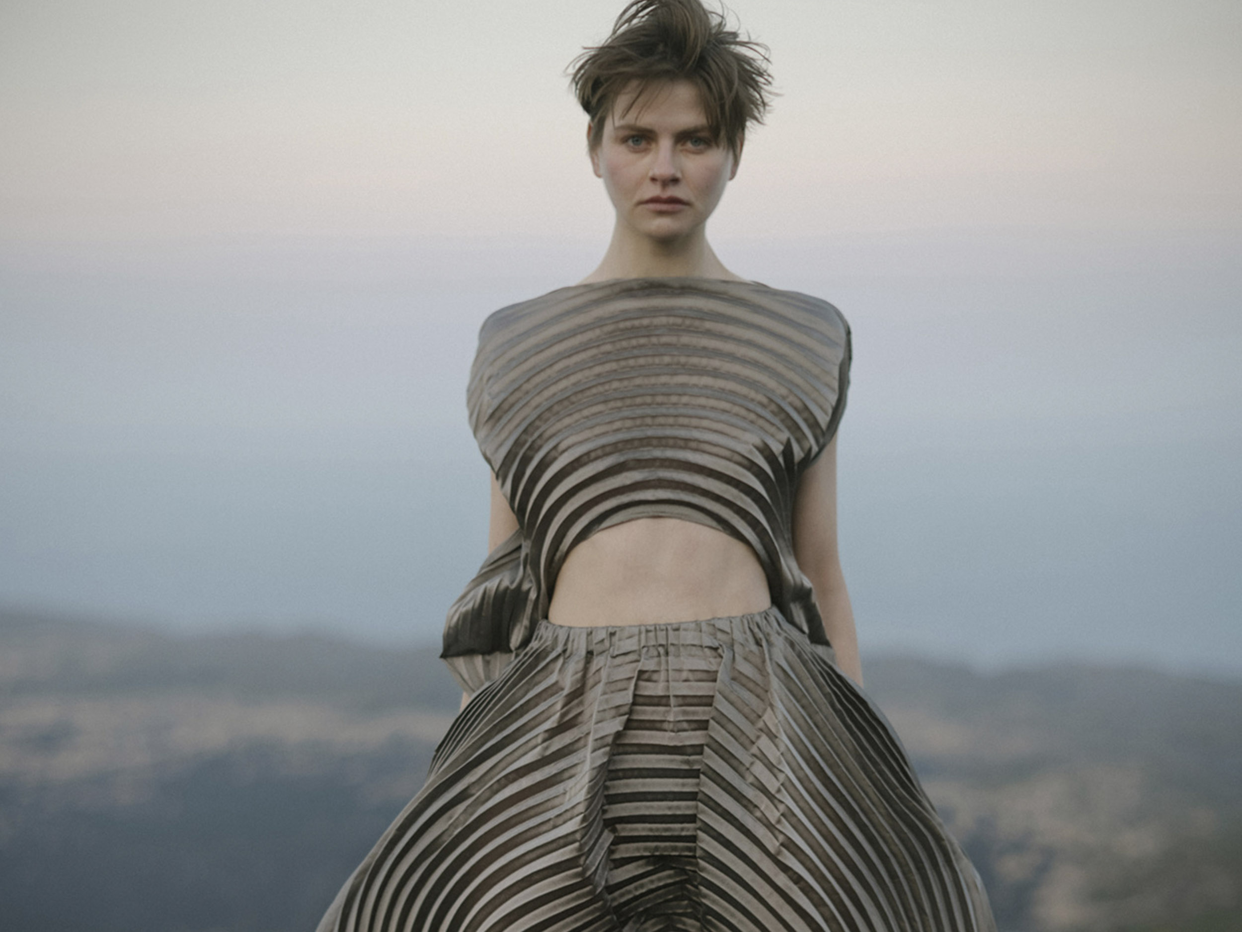 Issey Miyake strikes a sophisticated balance between organic beauty and futuristic utility