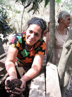 Figure 4: Worms and worm compost are produced by this woman on a very small parcel of land. Photo by Lance Edwards.