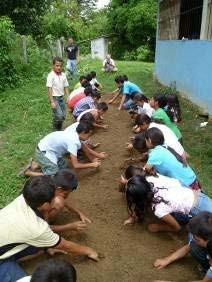 School children planting by a brick building