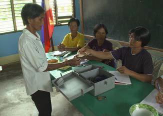 Figure 5: A Woman receiving a loan