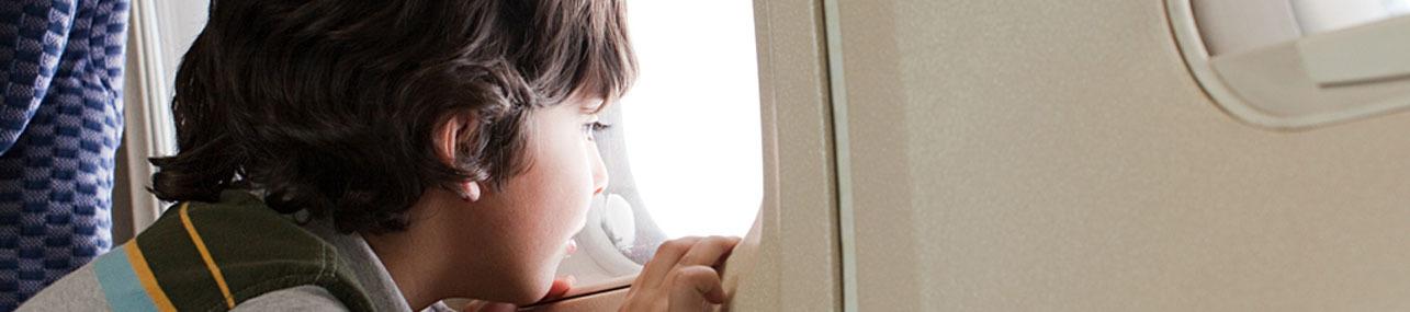 Boy lookingkout window