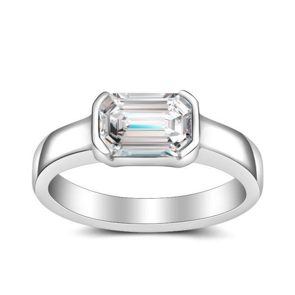 emerald cut diamond bezel set solitaire platinum
