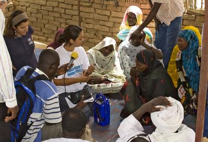 MINURCAT Civil Officer Distributes Radio Transmitters to Refugee Women