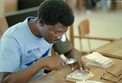 UNTAG Worker Verifies aTendered Ballot at Windhoek Election Centre