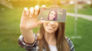 Pretty Woman Taking a Selfie For Online Photo