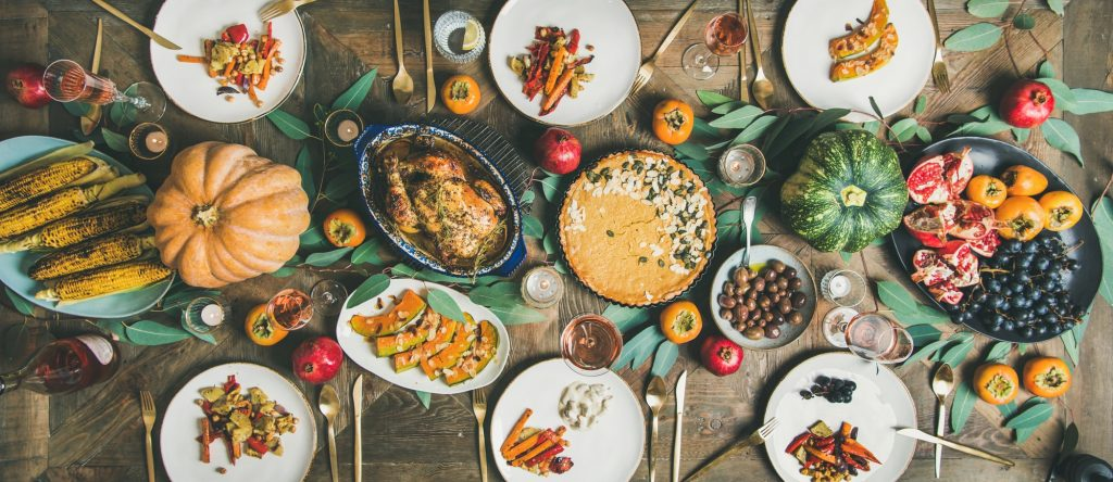 Flat-lay of different meals at Thanksgiving Day table