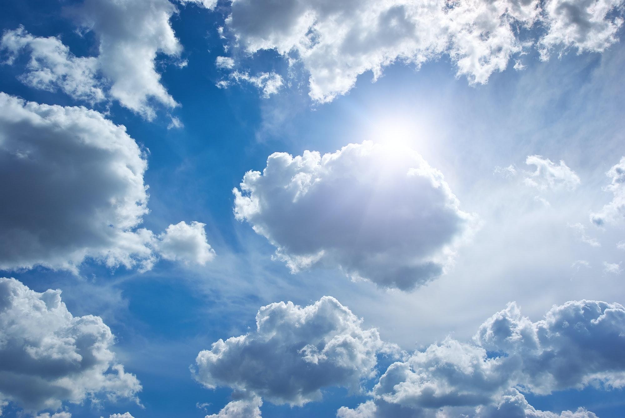 Blue skylight and fluffy cloud.