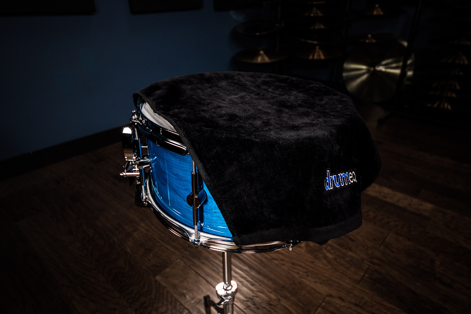 On the low end of the budget spectrum is the simple expedient of throwing some fairly heavy-weight towels or blankets over your acoustic drum kit.