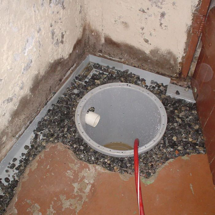 Installing a sump in a sump pump liner in a Warren home