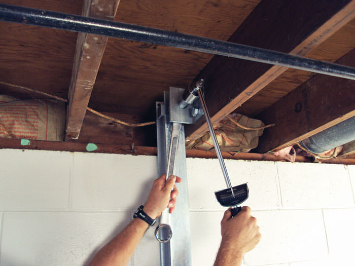 Straightening a foundation wall with the PowerBrace™ i-beam system in a Monroe home.