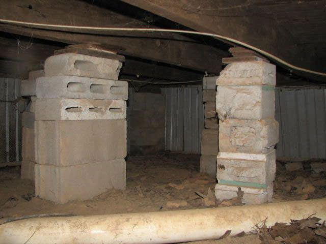 crawl space repairs done with concrete cinder blocks and wood shims in a Bay City home