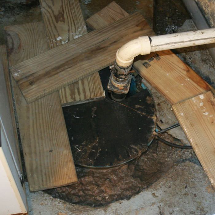 An ugly, clogged sump pump system in Midland, Michigan
