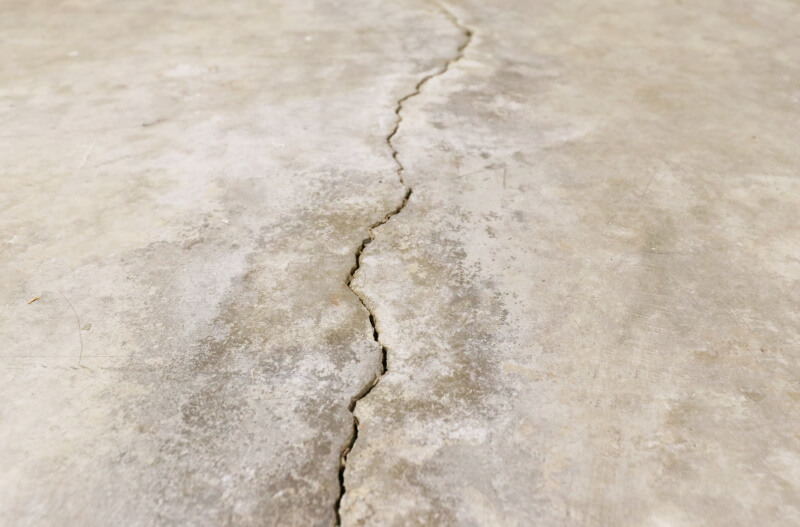 a severely damaged cracked concrete slab floor in Gaylord