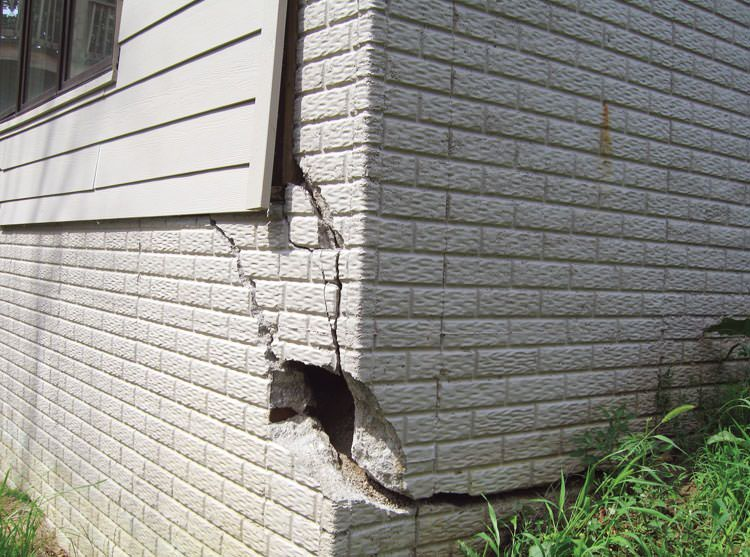 A severely damaged foundation wall in Traverse City