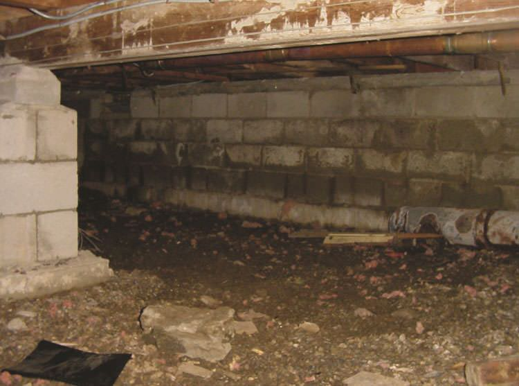Rotting, decaying crawl space wood damaged over time in Oscoda
